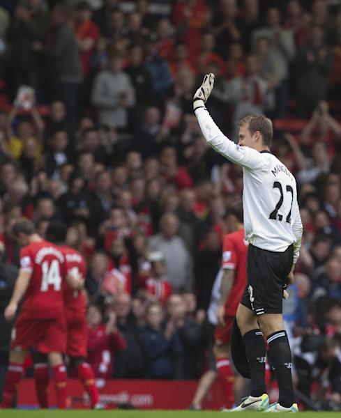 Liverpool's goalkeeper Simon Mignolet waves to supporters after his debut during his team's English Premier League soccer match against Stoke at Anfield Stadium, Liverpool, England, Saturday Aug. 17, 2013. (AP Photo/Jon Super)