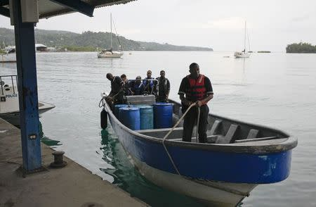Members of Jamaica's Marine Police return to port after leaving the site where it is presumed a small U.S. private plane with an unresponsive pilot crashed off the east coast of Jamaica, in Port Antonio September 5, 2014. REUTERS/Gilbert Bellamy