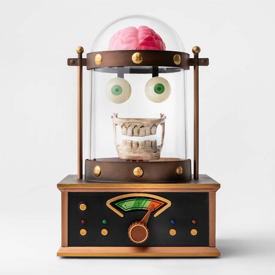 """<p><a href=""""https://www.popsugar.com/buy/Animated-Taking-Skull-Cloche-Halloween-468335?p_name=Animated%20Taking%20Skull%20in%20Cloche%20Halloween&retailer=target.com&pid=468335&price=35&evar1=moms%3Aus&evar9=46356115&evar98=https%3A%2F%2Fwww.popsugar.com%2Fphoto-gallery%2F46356115%2Fimage%2F46380246%2FAnimated-Taking-Skull-Cloche-Halloween&list1=target%2Challoween%2Challoween%20decor&prop13=api&pdata=1"""" rel=""""nofollow"""" data-shoppable-link=""""1"""" target=""""_blank"""" class=""""ga-track"""" data-ga-category=""""Related"""" data-ga-label=""""https://www.target.com/p/animated-taking-skull-in-cloche-halloween-d-233-cor-hyde-and-eek-boutique-8482/-/A-54393940"""" data-ga-action=""""In-Line Links"""">Animated Taking Skull in Cloche Halloween </a> ($35)</p>"""