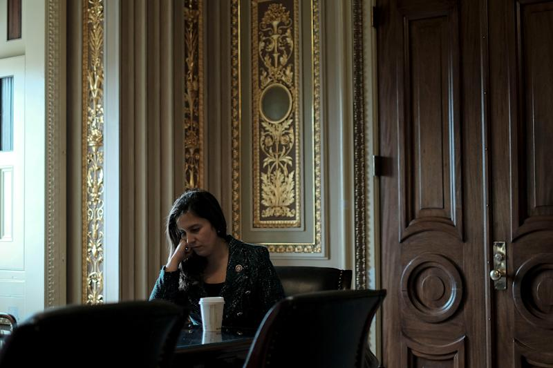 Rep. Elise Stefanik (R-N.Y.), an advisor to Trump's defense team, sits with her staffers outside the defense team meeting room before the impeachment trial at the Capitol in Washington, D.C., on Jan. 24, 2020. | Gabriella Demczuk for TIME