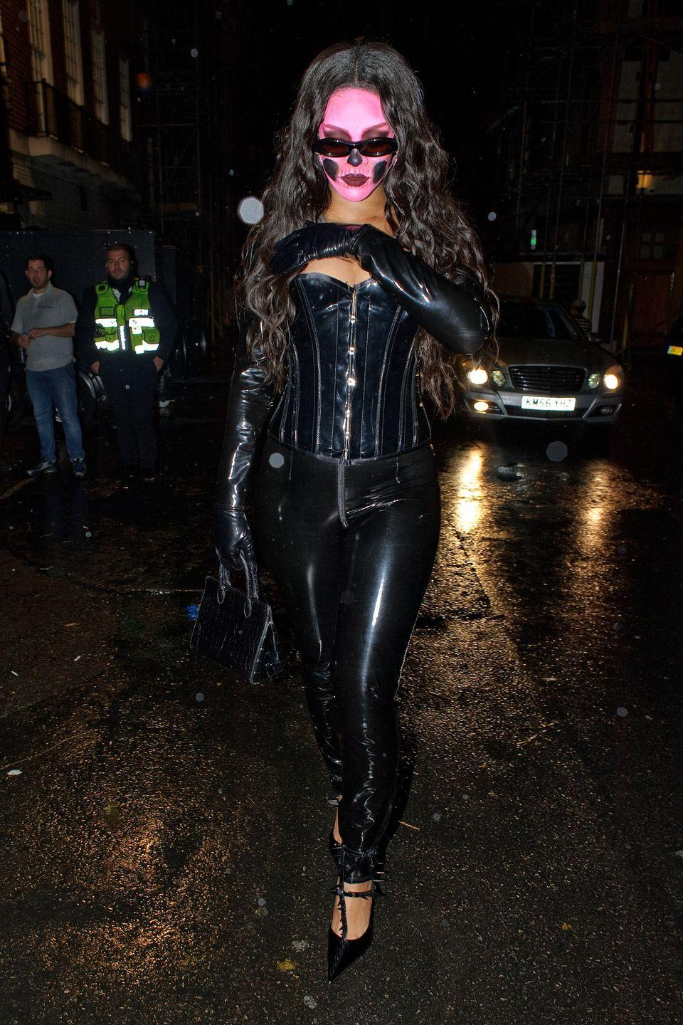 <p>For Halloween, Rih was spotted in a black latex corset, tonal slim-fit pants and gloves when she left Annabel's Halloween Party in Mayfair, London, England with bubblegum face paint on and and rose-tinted sunglasses.</p>