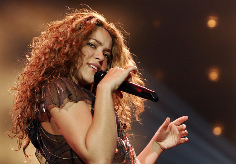 "FILE - In this Jan. 25, 2007 file photo, Colombian singer Shakira performs during the German opening concert of her  "" Oral Fixation Tour"" in Hamburg, Germany. NBC announced Monday, Sept. 17, 2012 that Usher and Shakira are joining ""The Voice"" as new coaches next spring, when Christina Aguilera and CeeLo Green take a break from the show. (AP Photo/Fabian Bimmer, File)"
