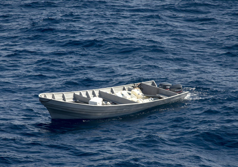 In this Nov. 27, 2019 photo provided by the U.S. Coast Guard,  a suspected drug-smuggling vessel floats in international waters of the Eastern Pacific Ocean after Coast Guard Cutter Bertholf, boarding teams interdicted the boat while patrolling the region. An estimated $312 million worth of cocaine seized from smugglers in the eastern Pacific Ocean has been brought to San Diego. About 18,000 pounds (8,165 kilograms) of the drug was offloaded Wednesday, Dec. 18, 2019, from the Coast Guard cutter Bertholf. (Petty Officer 2nd Class Paul Krug/U.S. Coast Guard via AP)
