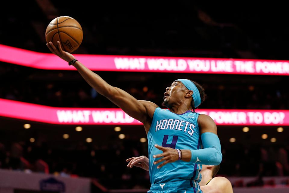 Charlotte Hornets guard Devonte' Graham drives to the basket against the Denver Nuggets during the first half of an NBA basketball game in Charlotte, N.C., Thursday, March 5, 2020. (AP Photo/Nell Redmond)