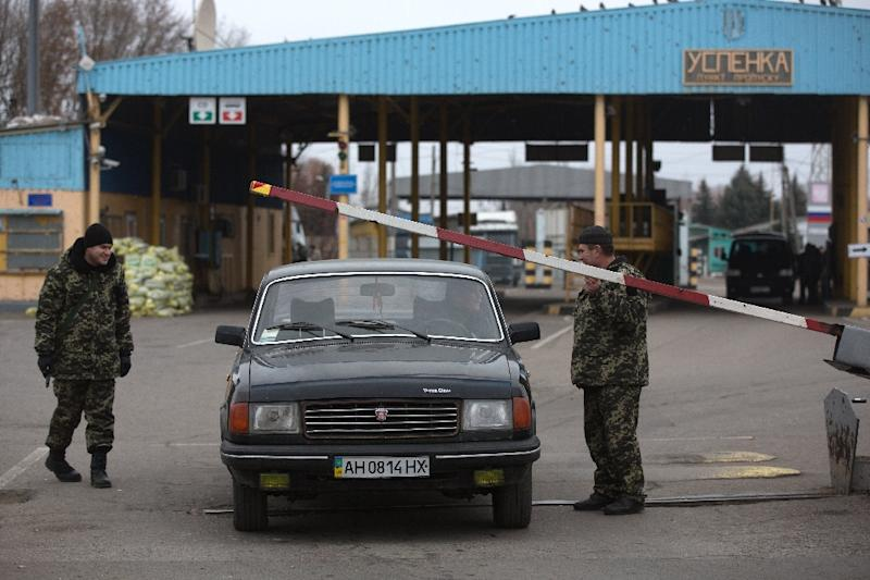 Pro-Russian separatists with the Donetsk People's Republic operate the border crossing from East Ukraine into Russia at Uspenka (AFP Photo/Menahem Kahana)