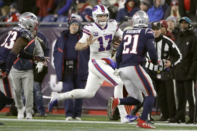 Buffalo Bills quarterback Josh Allen, center, runs with the ball as New England Patriots defenders Joejuan Williams, left, and Duron Harmon, right, give chase in the second half of an NFL football game, Saturday, Dec. 21, 2019, in Foxborough, Mass. (AP Photo/Steven Senne)
