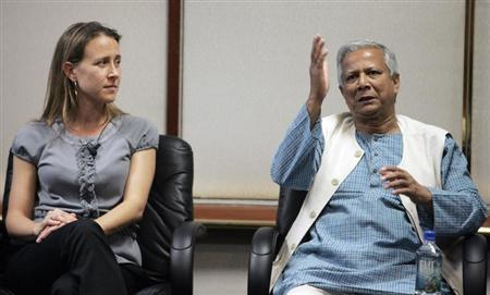 Anne Wojcicki and Nobel Peace Prize Laureate Muhammad Yunus at the 2008 Milken Institute Global Conference in Beverly Hills