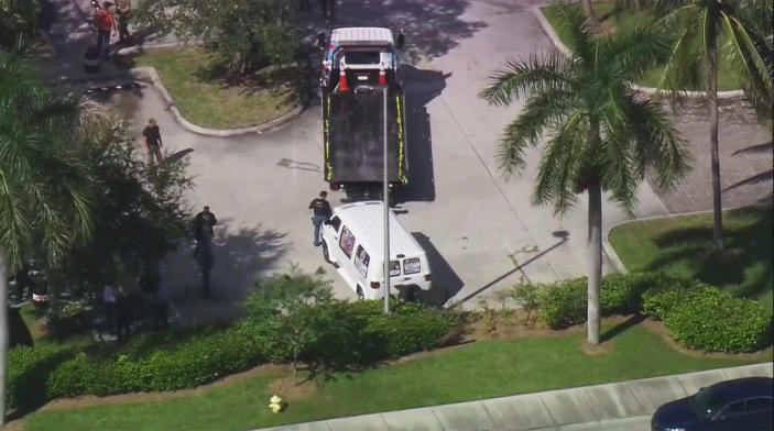 <p>In this frame grab from video provided by WPLG-TV, FBI agents and police officers prepare to load a suspicious van parked in Plantation, Fla., onto a flatbed tow truck on Friday, Oct. 26, 2018. (Photo: WPLG-TV via AP) </p>