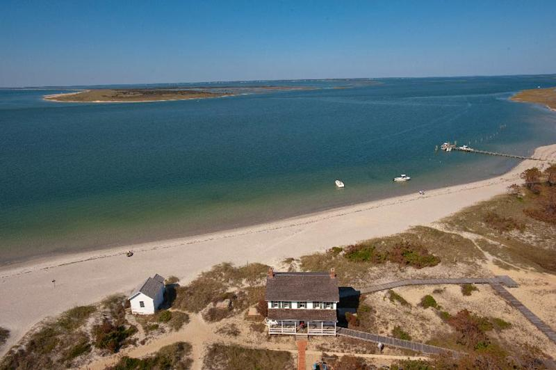 In an undated photo provided by VisitNC.com., a view from the top of the Cape Lookout Lighthouse shows the eastern end of Shackleford Banks, part of the Cape Lookout National Seashore. Beach communities and environmentalists are pushing back against a proposal to give the National Park Service the option of using sand to fight erosion on North Carolina's pristine Shackleford Banks. (AP Photo/VisitNC.com.,Bill Russ)