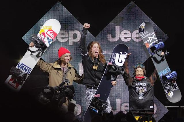 ASPEN, CO - JANUARY 29: Shaun White (C) celebrates as he takes the podium for the goal medal in the men's snowboard superpipe final along with Iouri Podladtchikov (L) of Switzerland in second place and Ryo Aono (R) of Japan in third place during Winter X Games 2012 at Buttermilk Mountain on January 29, 2012 in Aspen, Colorado. White earned his fifth consecutive gold medal in the event and scored a perfect 100 points on his final run. (Photo by Doug Pensinger/Getty Images)