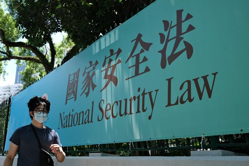 A man walks past a government public notice banner for the National Security Law in Hong Kong. Source: Getty Images