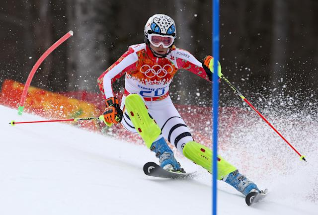 Germany's Maria Hoefl-Riesch passes a gate in the slalom portion of the women's supercombined to win the gold medal in the Sochi 2014 Winter Olympics, Monday, Feb. 10, 2014, in Krasnaya Polyana, Russia.(AP Photo/Alessandro Trovati)