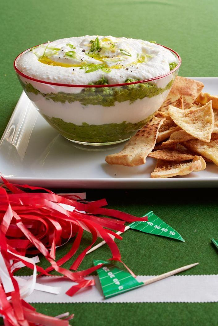"""<p>Seven-layer dip has nothing on this creamy, cheesy pea dip. Serve it alongside these <a href=""""https://www.womansday.com/food-recipes/food-drinks/recipes/a53336/cumin-spiced-pita-chips/"""" rel=""""nofollow noopener"""" target=""""_blank"""" data-ylk=""""slk:cumin-spiced pita chips"""" class=""""link rapid-noclick-resp"""">cumin-spiced pita chips</a>.</p><p><a href=""""https://www.womansday.com/food-recipes/food-drinks/recipes/a53333/creamy-layered-pea-dip/"""" rel=""""nofollow noopener"""" target=""""_blank"""" data-ylk=""""slk:Get the Creamy Layered Pea Dip recipe."""" class=""""link rapid-noclick-resp""""><em>Get the Creamy Layered Pea Dip recipe.</em></a> </p>"""