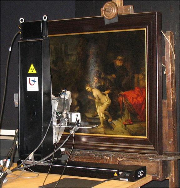 A macro X-ray fluorescence scanner next to the Rembrandt painting, 'Susanna and the Elders,' at the Gemäldegalerie museum in Berlin.