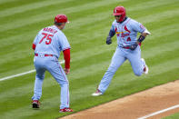 St. Louis Cardinals' Yadier Molina (4) runs past third base coach Ron 'Pop' Warner (75) after hitting a three-run homer during the third inning of a baseball game against the Philadelphia Phillies, Saturday, April 17, 2021, in Philadelphia. (AP Photo/Laurence Kesterson)