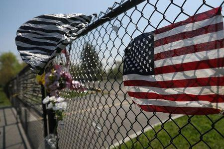 A makeshift memorial stands outside a park, where bodies of four men were found on April 13, in Central Islip, New York, U.S., April 28, 2017.  REUTERS/Shannon Stapleton