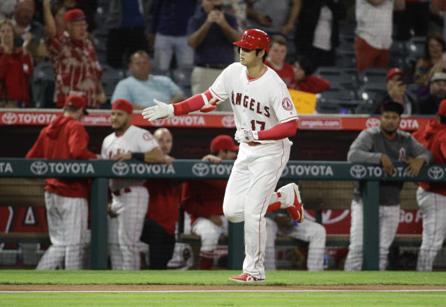 Los Angeles Angels' Shohei Ohtani, of Japan, celebrates after his home run against the Texas Rangers during the first inning of a baseball game in Anaheim, Calif., Monday, Sept. 24, 2018. (AP Photo/Chris Carlson)