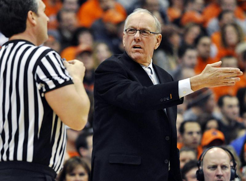 Syracuse head coach Jim Boeheim questions a call during the first half of an NCAA college basketball game against Rutgers in Syracuse, N.Y., Wednesday, Jan. 2, 2013. (AP Photo/Kevin Rivoli)