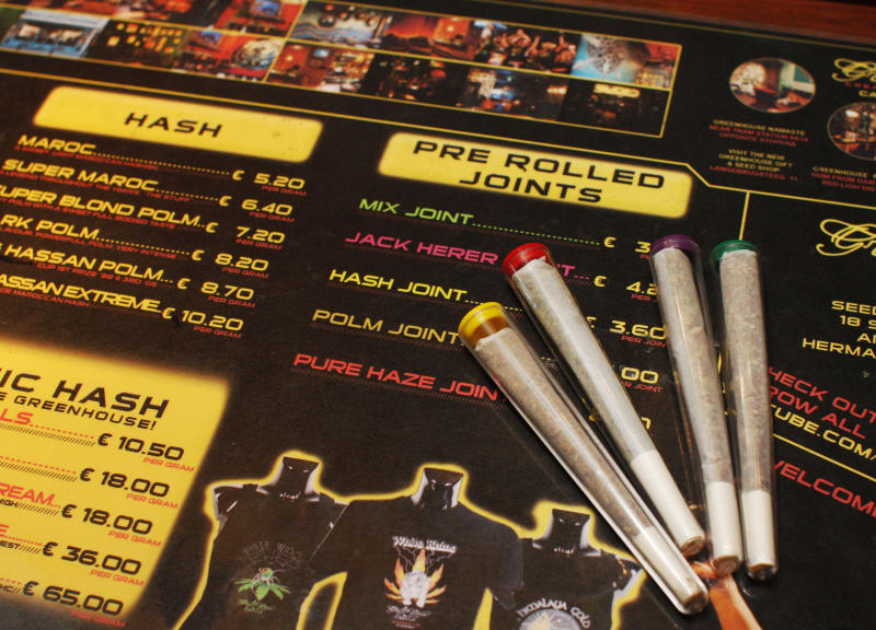 """FILE - In this June 15, 2008 file photo, pre-rolled joints are seen on an english language menu listing the variety of hash and marijuana on sale at The Green House coffee shop in Amsterdam, Netherlands. The new Dutch government is scrapping a planned """"weed pass"""" designed to keep foreigners out of the nation's cannabis-selling coffee shops. Justice Minister Ivo Opstelten said late Monday, Nov. 19, 2012 that the passes are being immediately scrapped. (AP Photo/Peter Dejong, File)"""