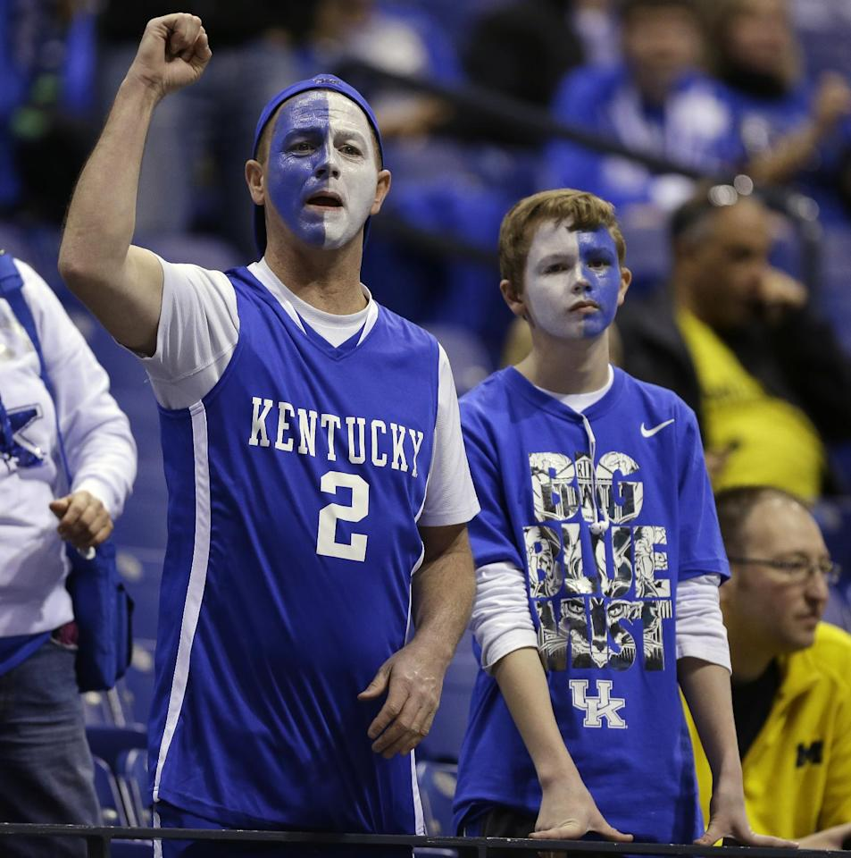 Kentucky fan cheer before an NCAA Midwest Regional final college basketball tournament game against Michigan Sunday, March 30, 2014, in Indianapolis. (AP Photo/Michael Conroy)