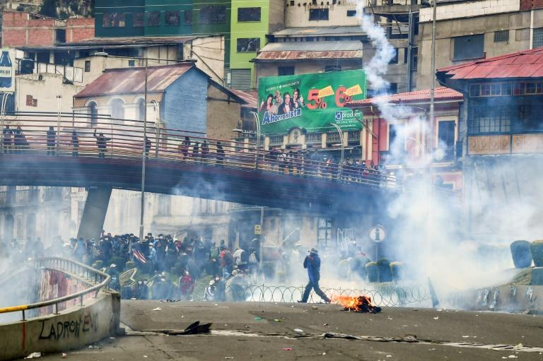 Morales supporters clash with riot police in La Paz on November 13 (AFP Photo/RONALDO SCHEMIDT)