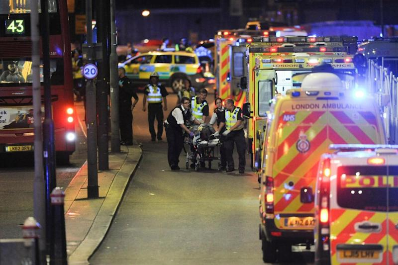 Protocol: paramedics attend to a person injured in a terror attack (AFP/Getty Images)
