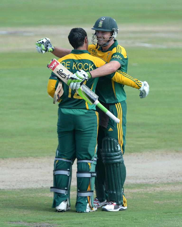 CENTURION, SOUTH AFRICA - DECEMBER 11: Quinton de Kock of South Africa celebrates his third consecutive century with AB de Villiers during the 3rd Momentum ODI match between South Africa and India at SuperSport Park on December 11, 2013 in Centurion, South Africa. (Photo by Duif du Toit/Gallo Images/Getty Images)