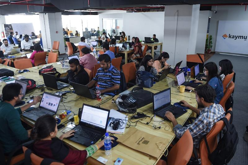 Pakistani employees of online marketplace company Kaymu work in Karachi (AFP Photo/Asif Hassan)