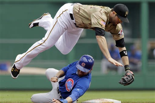 Chicago Cubs' David DeJesus, bottom, upends Pittsburgh Pirates second baseman Neil Walker to break up a double play on Cubs' Starlin Castro in the first inning of a baseball game in Pittsburgh, Sunday, May 27, 2012. (AP Photo/Gene J. Puskar)