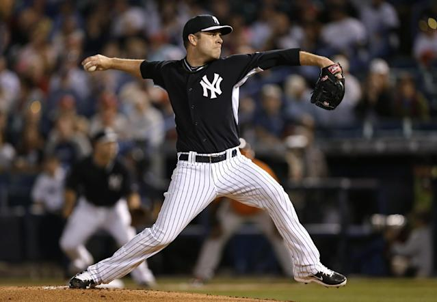 New York Yankees starter David Phelps throws a pitch during the first inning of an exhibition baseball game against the Baltimore Orioles on Tuesday, March 4, 2014, in Tampa, Fla. (AP Photo/Charlie Neibergall)