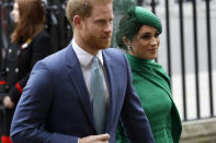 FILE - In this March 9, 2020, file photo, Britain's Harry and Meghan the Duke and Duchess of Sussex arrive to attend the annual Commonwealth Day service at Westminster Abbey in London. Almost as soon as Meghan and Prince Harry's interview with Oprah Winfrey aired, many were quick to deny Meghan's allegations of racism on social media. Many say it was painful to watch Meghan's experiences with racism invalidated by the royal family, members of the media and the public, offering up yet another example of a Black woman's experience being disregarded and denied. (AP Photo/Kirsty Wigglesworth, File)