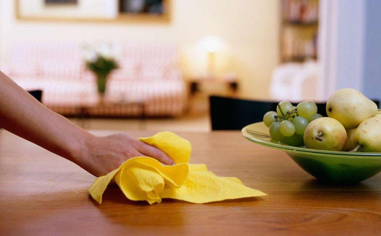 dusting and wiping kitchen table