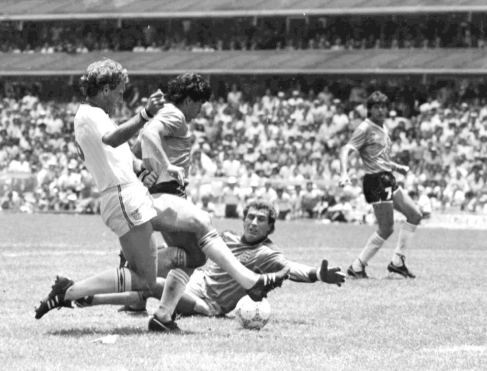 FILE - In this June 22, 1986 file photo, Argentina's Diego Maradona, second left, is about to score his second goal against England, during their World Cup quarte final soccer match, in Mexico City. England's Terry Butcher, left, tries to tackle Maradona, while England's goalkeeper Peter Shilton is on the ground. Argentina won the match 2-1. (AP Photo/File)