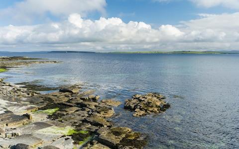 Coastal landscape on Papa Westray, a small island in the Orkney archipelago - Credit: Danita Delimont/Alamy