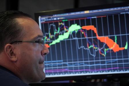 A specialist trader works at his post on the floor at the NYSE in New York