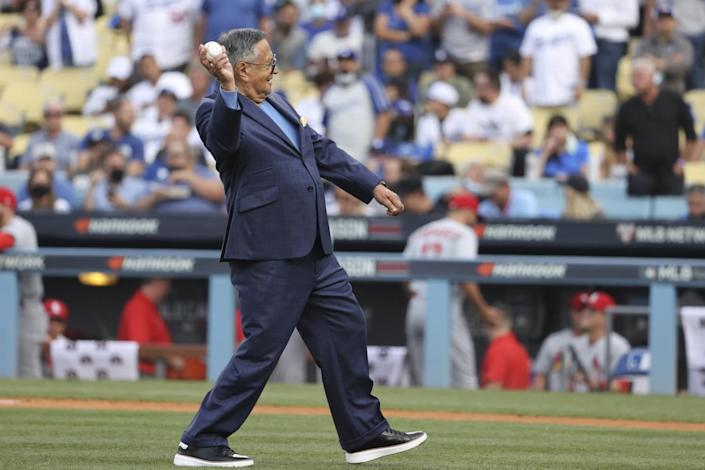 The Spanish language voice of the Los Angeles Dodgers Jaime Jarrin delivers the first pitch before the game