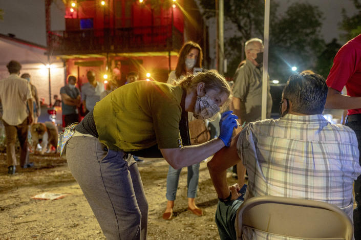 People are vaccinated outside a live music venue in New Orleans on April 9, 2021. (Emily Kask/The New York Times)