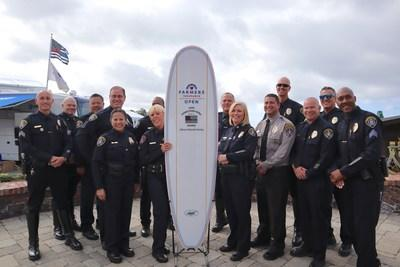 Farmers Insurance Open Hometown Hero Award recipient Officer Deborah Ganely (left of the surfboard) is pictured with her unit after accepting the inaugural award.