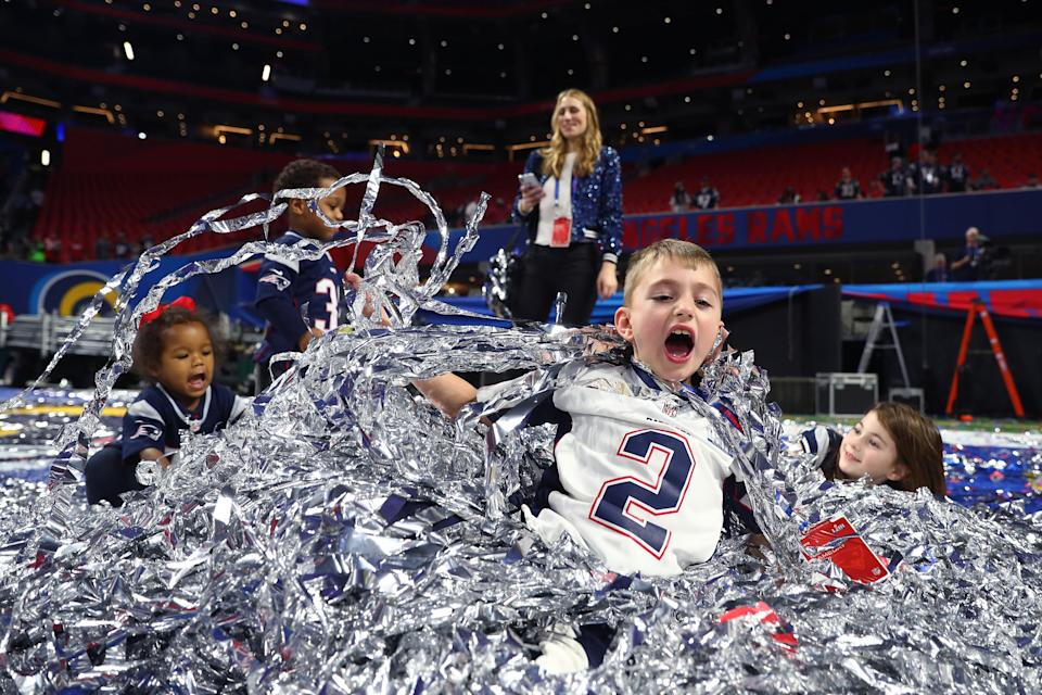 <p>Children of Patriots players play in the confetti after the New England Patriots 13-3 win over the Los Angeles Rams during Super Bowl LIII at Mercedes-Benz Stadium on February 03, 2019 in Atlanta, Georgia. (Photo by Maddie Meyer/Getty Images) </p>