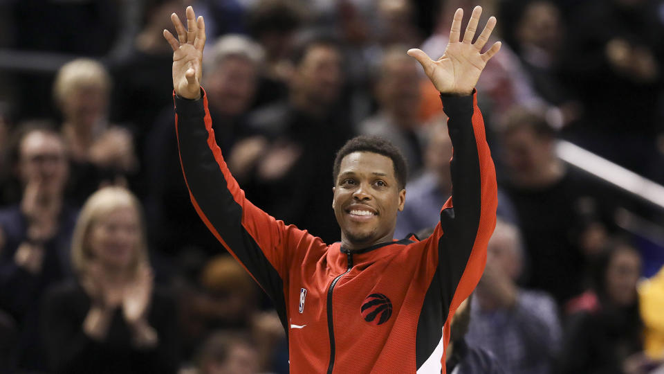 Former Toronto Raptors guard Kyle Lowry (7) acknowledges the crowd before a game. (Richard Lautens/Toronto Star via Getty Images)