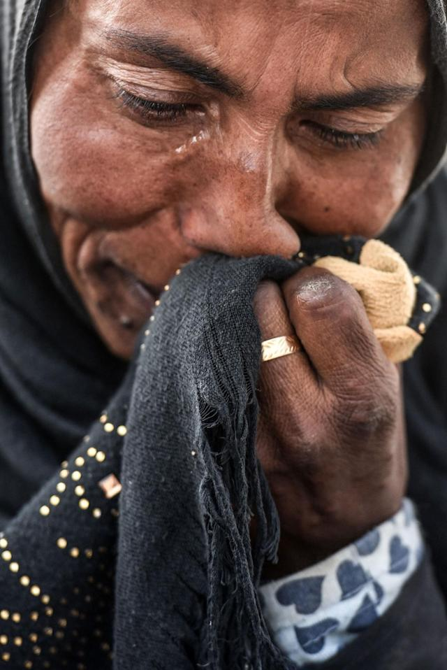 <p>A displaced Iraqi woman wipes away tears at the Hasan Sham camp for Internally Displaced People on June 10, 2017. (Photo: Mohaned El-Shahed/AFP/Getty Images) </p>