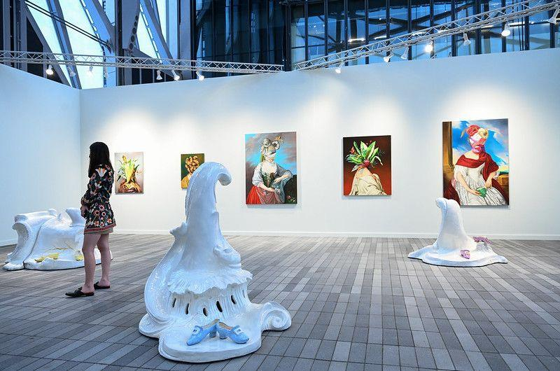 """<p>After more than a year without art fairs, <a href=""""https://www.frieze.com/tags/frieze-new-york-2021"""" rel=""""nofollow noopener"""" target=""""_blank"""" data-ylk=""""slk:Frieze New York"""" class=""""link rapid-noclick-resp"""">Frieze New York</a> is back. But this highly anticipated pandemic-era edition looked a little different. Rather than setting up shop in the usual sprawling tent on Randall's Island, some 60 international galleries occupied <a href=""""https://theshed.org/"""" rel=""""nofollow noopener"""" target=""""_blank"""" data-ylk=""""slk:the Shed"""" class=""""link rapid-noclick-resp"""">the Shed</a>, the multidisciplinary performing arts space in Hudson Yards on Manhattan's West Side. Visitors, of course, were also subject to strict COVID-19 guidelines. Despite these tweaks, it was a pleasure to leave the house and see such an abundance of art—and people—outside of a museum. And though the in-person show closed to the public May 9, you can still take part through Frieze's expanded <a href=""""https://www.frieze.com/fairs/frieze-viewing-room"""" rel=""""nofollow noopener"""" target=""""_blank"""" data-ylk=""""slk:virtual viewing room"""" class=""""link rapid-noclick-resp"""">virtual viewing room</a> of 160 exhibitors through Friday, where you can watch interviews with architect Annabelle Selldorf, performance artist Marina Abramović, and more. </p><p>It's impossible, of course, to select favorites among the hundreds of works that were on display during the IRL event, but here are a few that caught our eye.</p>"""