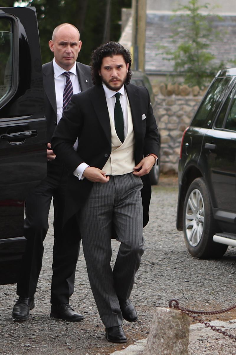 RETRANSMITTED WITH CORRECTED CAPTION Groom Game of Thrones star Kit Harington, who plays Jon Snow, arriving at Rayne Church in the village of Kirkton of Rayne, Aberdeenshire, for his wedding ceremony with his co-star Rose Leslie, who played Ygritte in the drama. (Photo by Jane Barlow/PA Images via Getty Images)