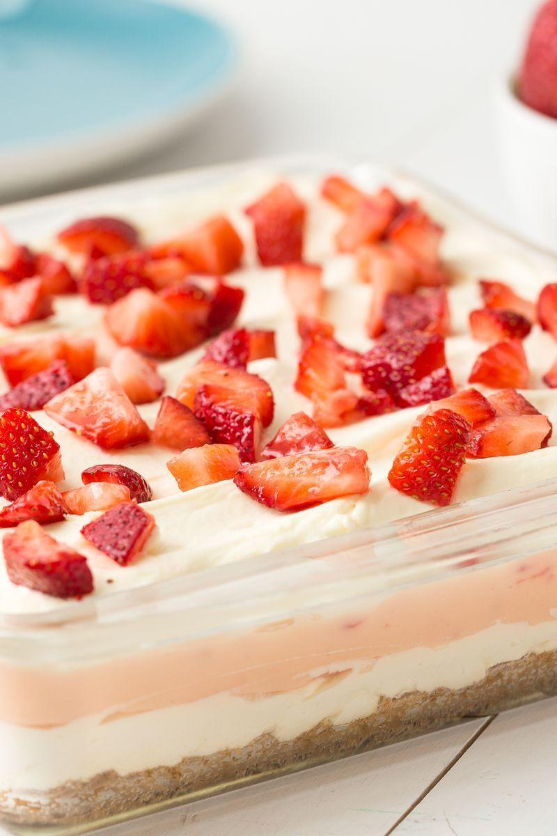 """<p>Dig into three dreamy layers of dessert.</p><p>Get the <a href=""""https://www.delish.com/uk/cooking/recipes/a32233148/strawberry-cheesecake-lasagna-recipe/"""" rel=""""nofollow noopener"""" target=""""_blank"""" data-ylk=""""slk:Strawberry Cheesecake Lasagne"""" class=""""link rapid-noclick-resp"""">Strawberry Cheesecake Lasagne</a> recipe.</p>"""