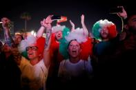 FILE PHOTO: Fans react as they listen to the 2019 Eurovision song contest final in the fans zone by the beach in Tel Aviv, Israel