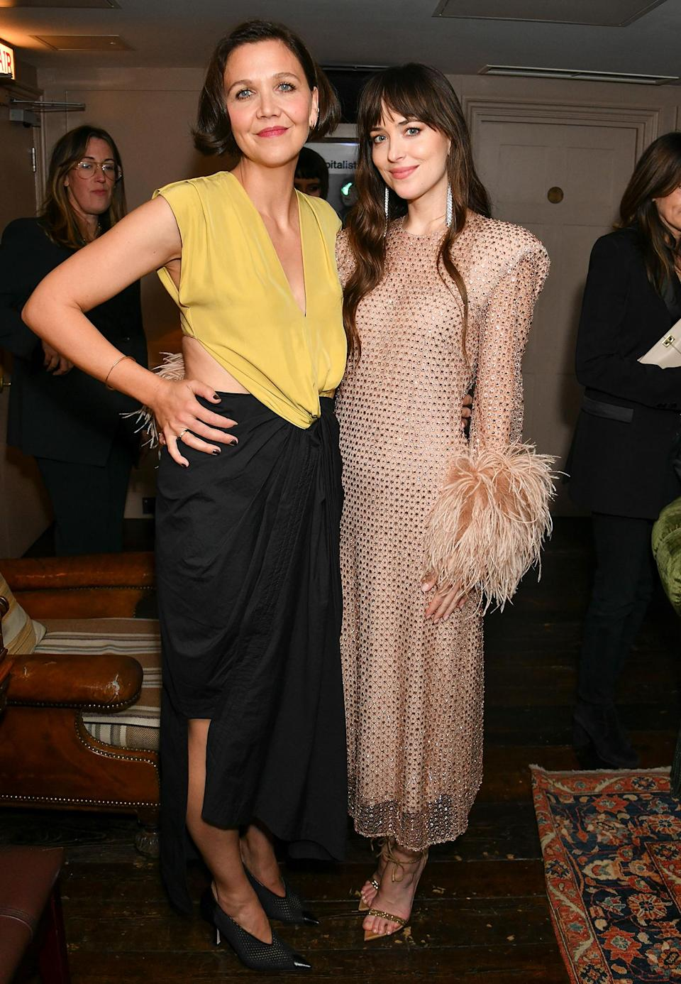 <p>Making her directorial debut with the film <em>The Lost Daughter,</em> Maggie Gyllenhaal joins Dakota Johnson, who plays Nina, at the Tastemaker screening in London on Oct. 13.</p>