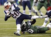New England Patriots strong safety Steve Gregory (28) is tackled by New York Jets running back Bilal Powell (29) after intercepting a pass during the first half of an NFL football game on Thursday, Nov. 22, 2012, in East Rutherford, N.J. (AP Photo/Bill Kostroun)
