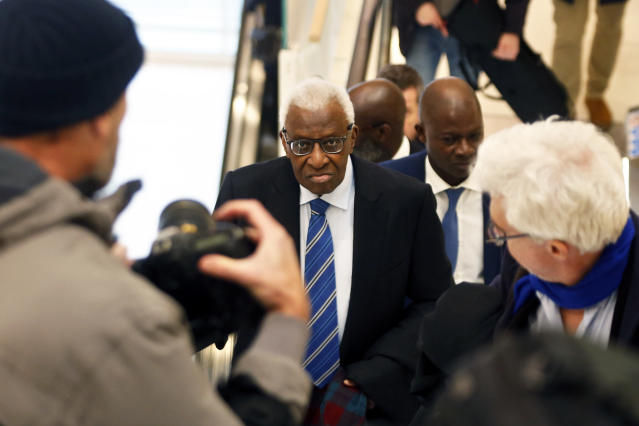 Former president of the IAAF (International Association of Athletics Federations) Lamine Diack, center, arrives at the Paris courthouse, Monday, Jan. 13, 2020. One of the biggest sports corruption cases to reach court is being heard in Paris from Monday, with explosive allegations of a massive doping cover-up at the top of track and field. (AP Photo/Thibault Camus)
