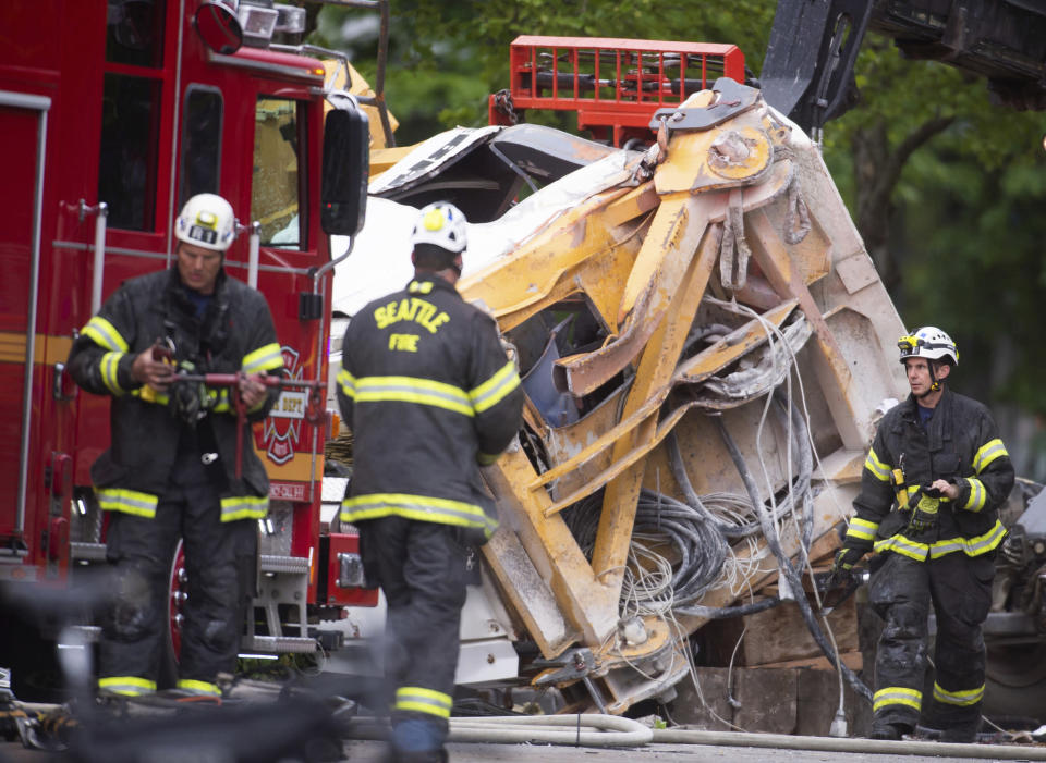 Emergency crews work the scene of a construction crane collapse near the intersection of Mercer Street and Fairview Avenue near Interstate 5 in Seattle, on Saturday, April 27, 2019. Authorities say several people have died and a few others are hospitalized after the construction crane fell onto a street in downtown Seattle on Saturday afternoon. (Joshua Bessex/The News Tribune via AP)