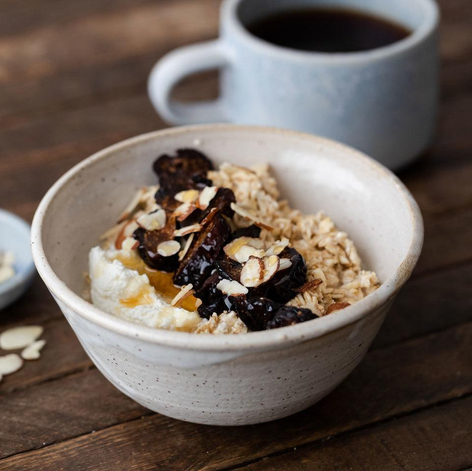 """<p>With just a bit of work before bed, you can have a fast but decadent breakfast in the morning. These overnight oats """"cook"""" while you sleep. Toast almonds and chop figs the night before, so that when you rise, you can just stir in the fruit, nuts, honey and ricotta cheese for a hearty, sweet and creamy breakfast. <a href=""""https://www.eatingwell.com/recipe/269659/fig-ricotta-overnight-oats/"""" rel=""""nofollow noopener"""" target=""""_blank"""" data-ylk=""""slk:View Recipe"""" class=""""link rapid-noclick-resp"""">View Recipe</a></p>"""